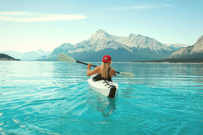 woman kayaking effortlessly on a lake
