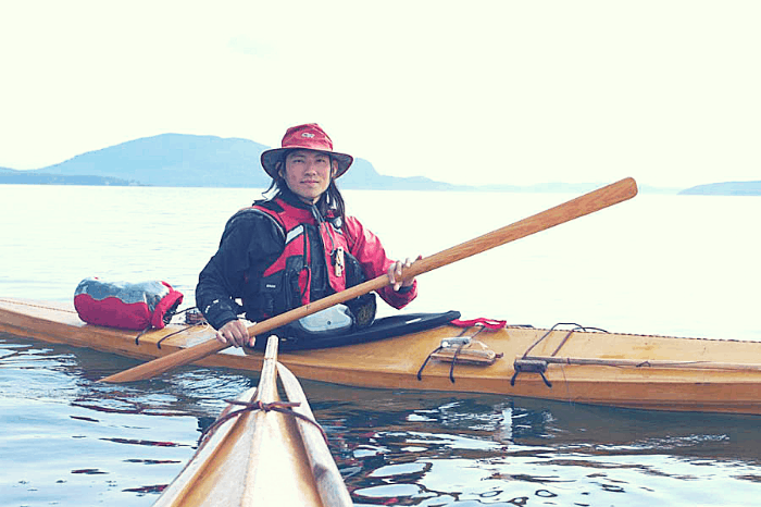 a kayaker with a greenland paddle