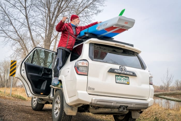 Picture showing how to put a SUP on a car rack