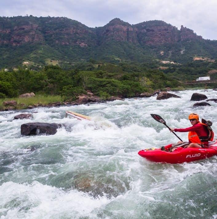 Kayaking On A Class III Rapid